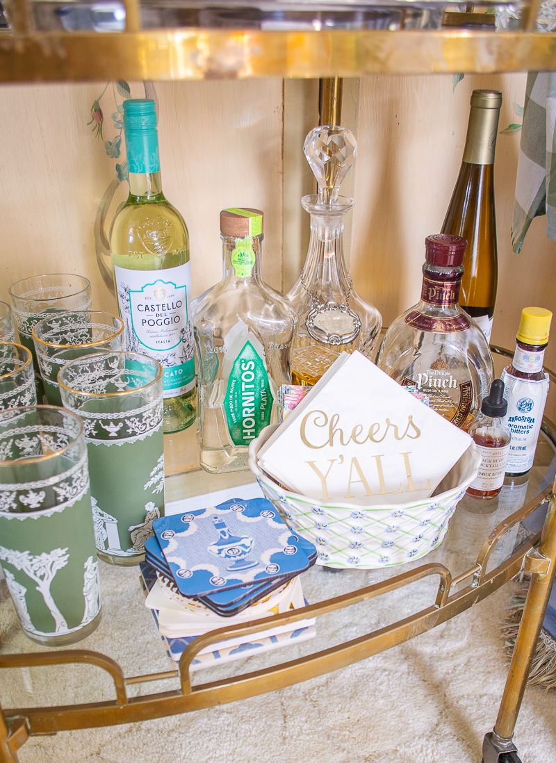 Bottom shelve of bar cart with coasters and cocktail napkins