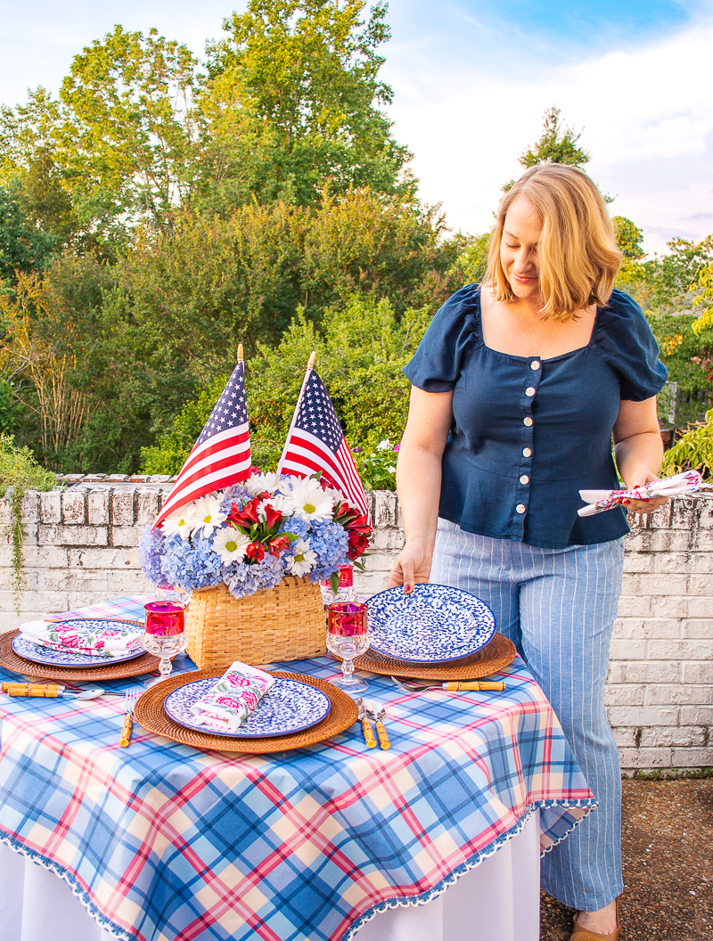 Katherine places blue and white spongeware plate on table