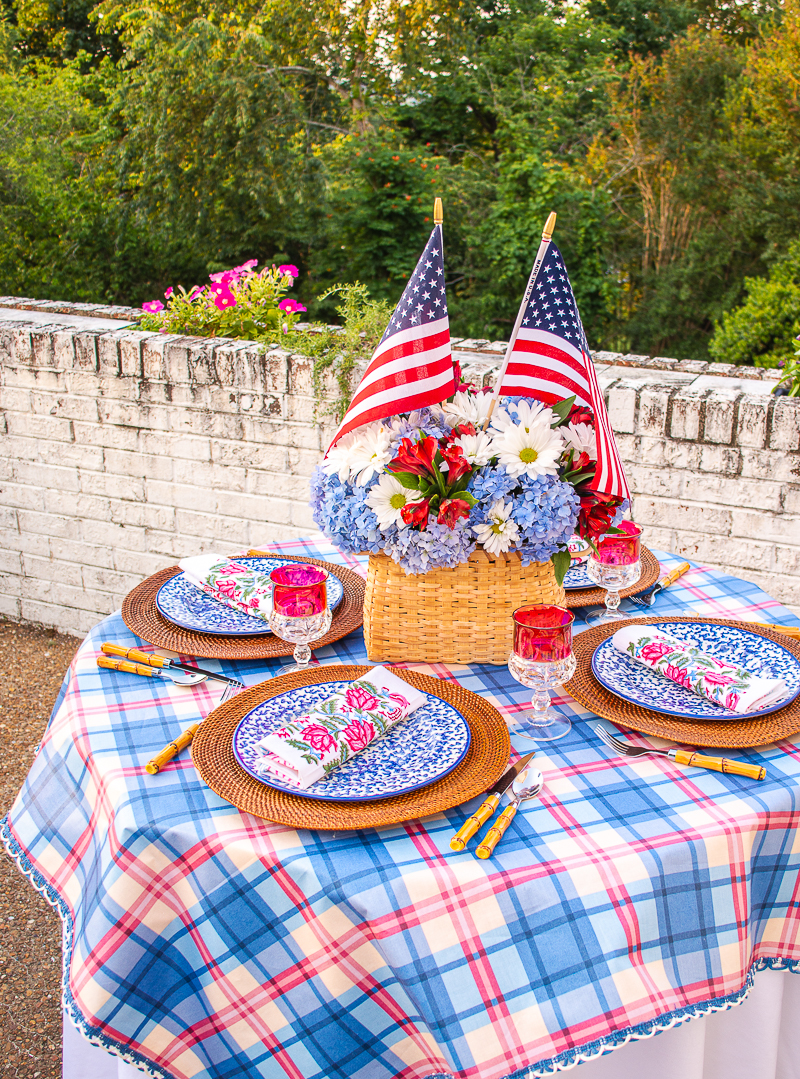 4th of July tablescape with American decor featuring plaid tablecloth and blue splatterware plates