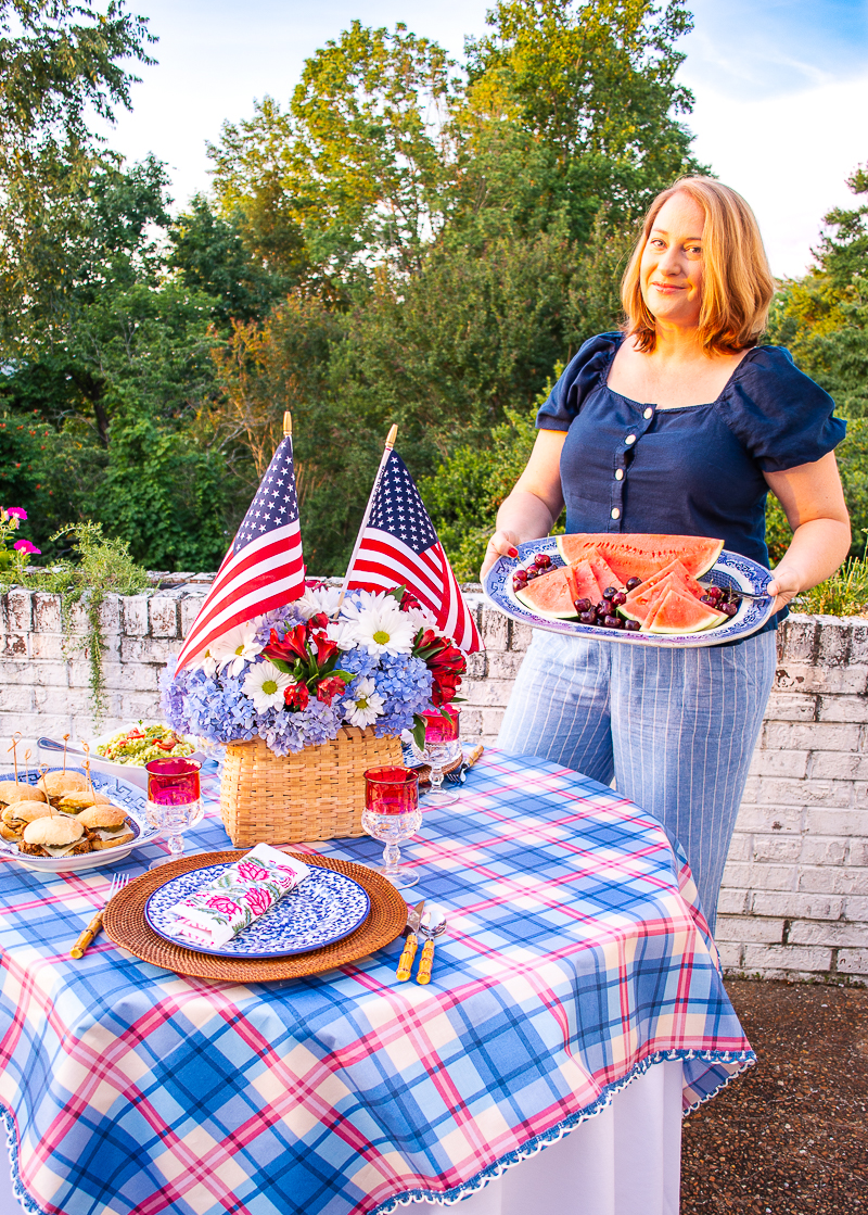 Katherine holding platter of watermelon for 4th of July BBQ made easy menu idea