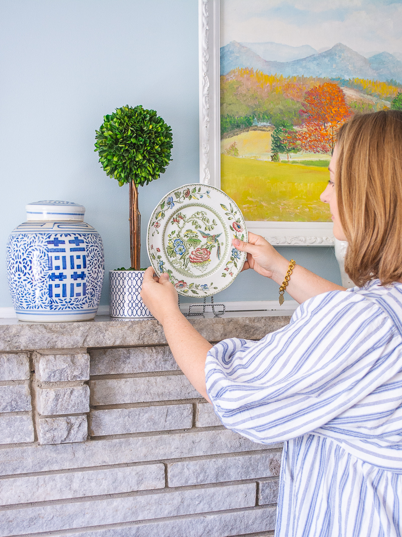 Katherine places Chinoiserie plate on mantel to complete the look