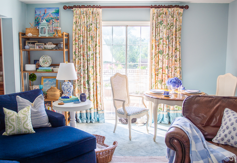 blue and white family room reveal - view of sliding door with new floral curtains