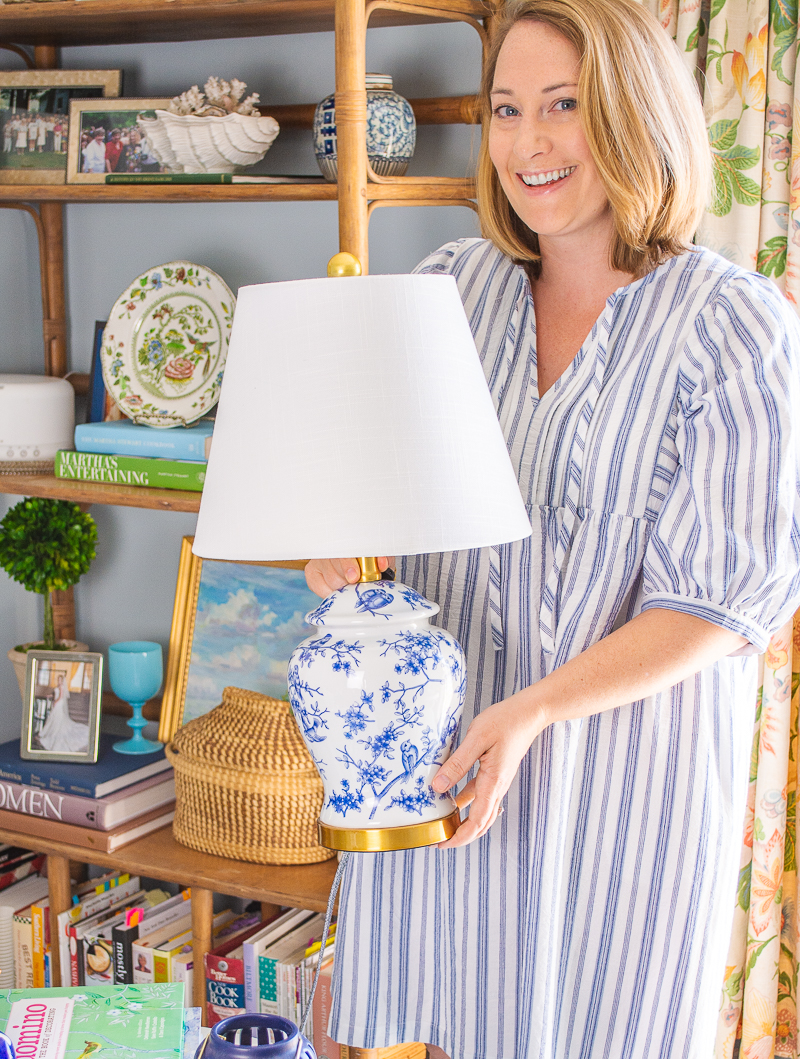 Katherine places new blue and white Chinoiserie lamp from Birch Lane on end table in family room