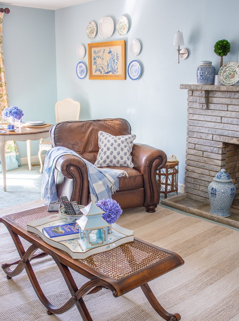 Family room refresh with new Chinoiserie accents, art, and leather arm chair