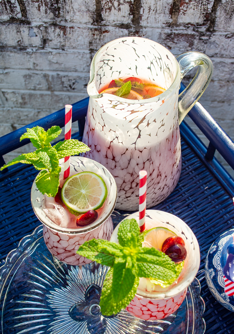 Summer pitcher cocktail with cherry lemonade and vodka