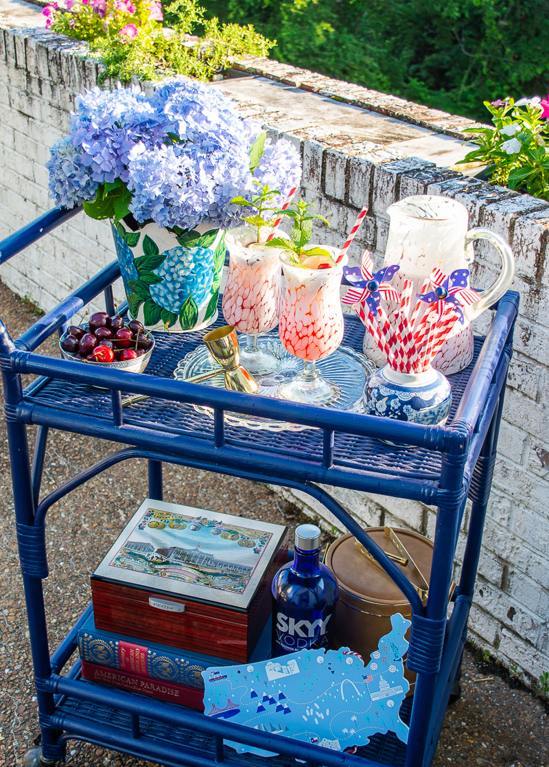 4th of July bar cart with hydrangeas and paper straws and flag pinwheels