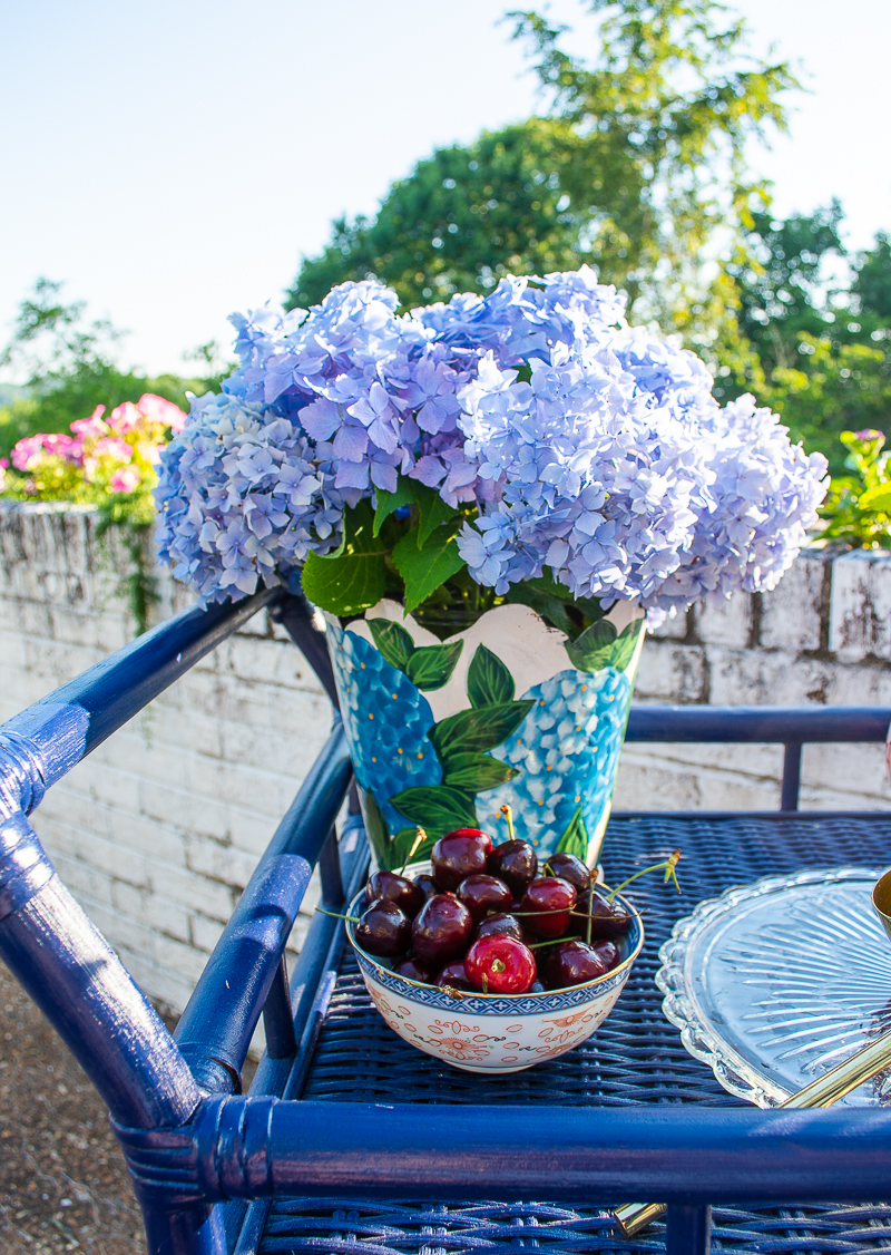 Festive July 4th bar cart with tleware vase filled with blue hydrangea
