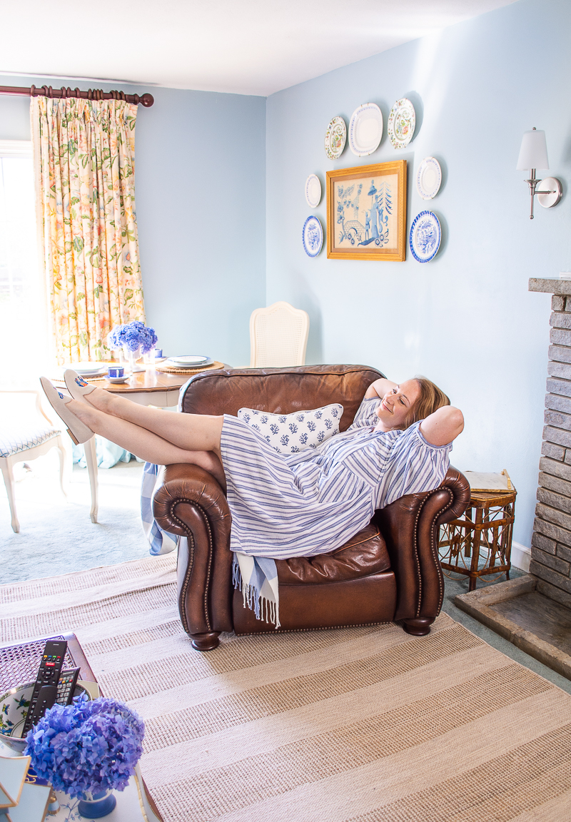 Katherine relaxes in arm chair enjoying her family room refresh!