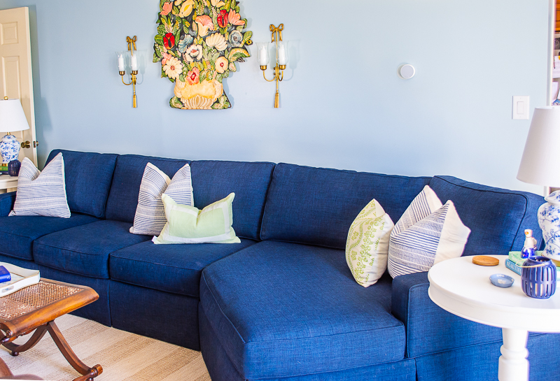 Navy sectional sofa with new pillows from Birch Lane and new art work above