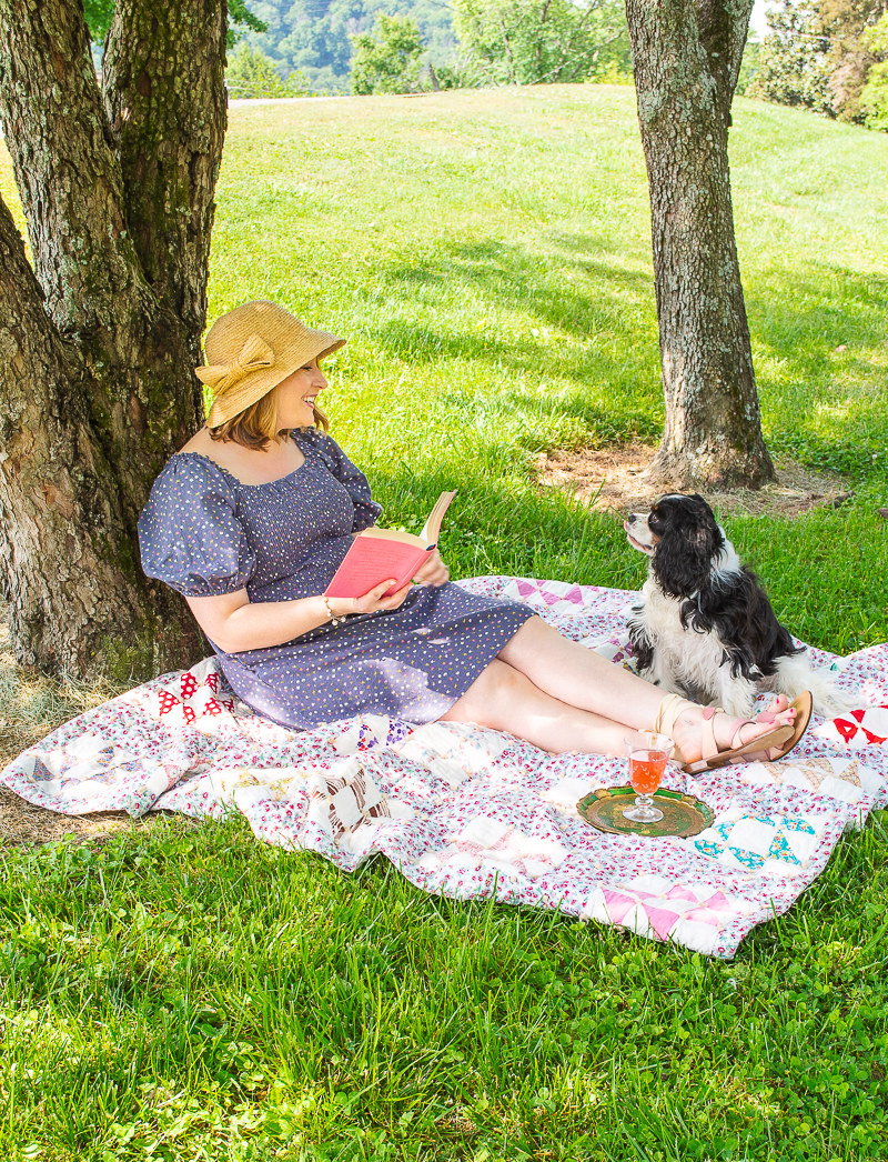 Katherine and Henry reading under a shady tree on a summer afternoon.