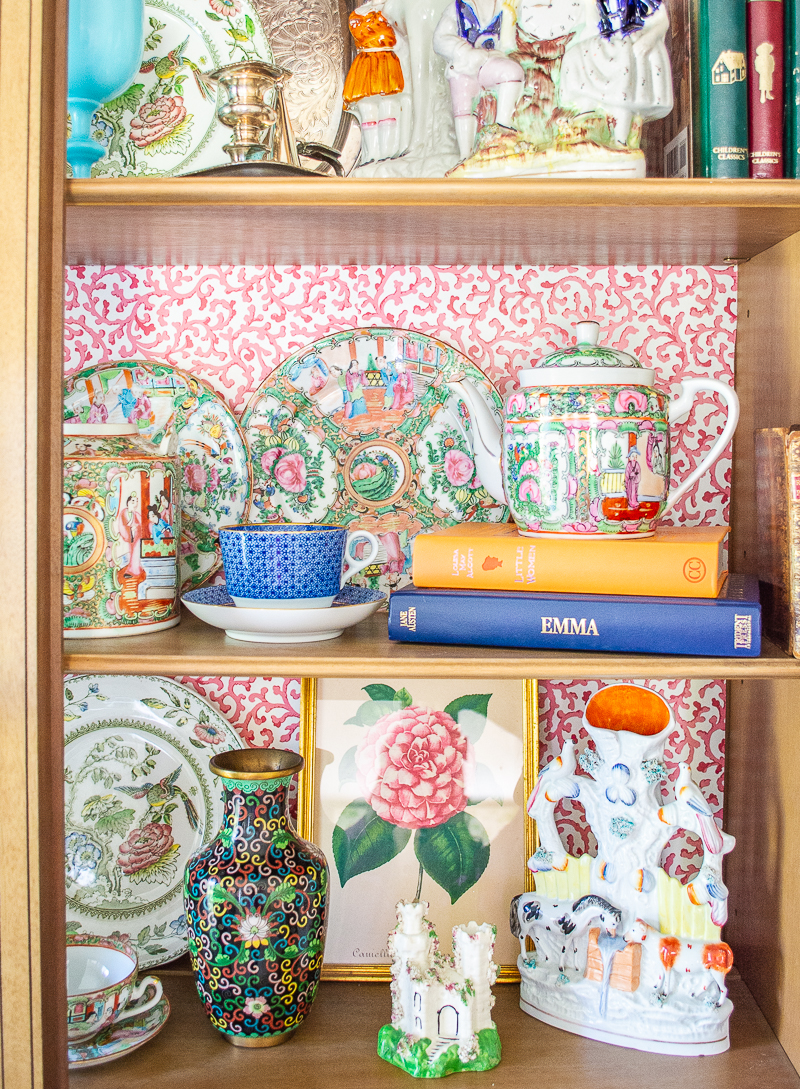 Colorful shelving styled with Rose Medallion tableware