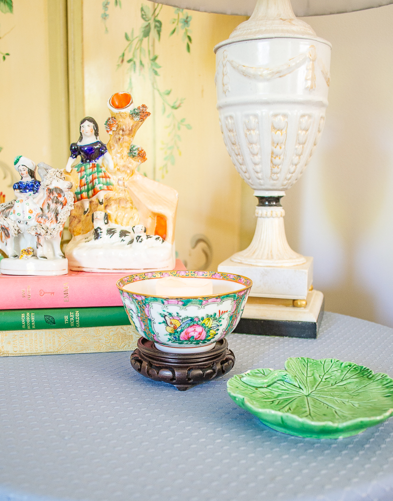 Table vignette with Rose Canton tea bowl used as candle holder