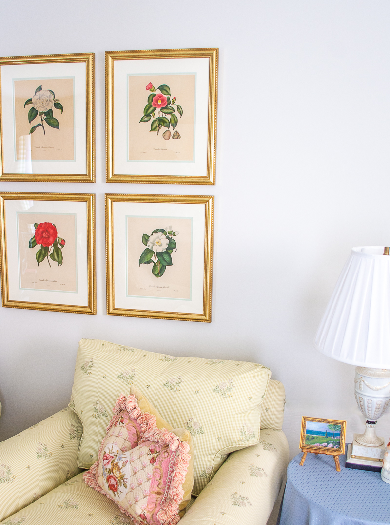 Angled view of camellia prints on wall in grid style layout