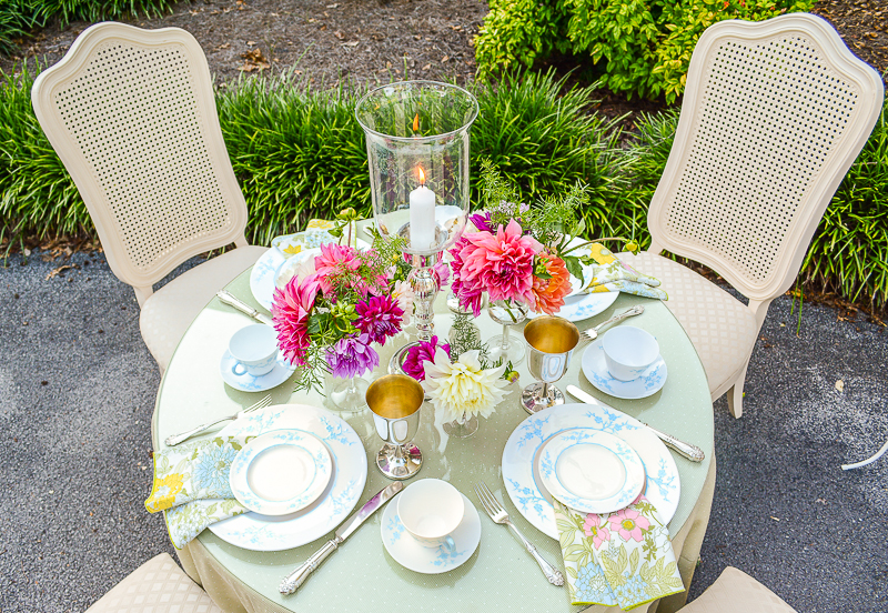 A pretty summer table al fresco with pale green linens, vintage silver, Spode china, and dahlias