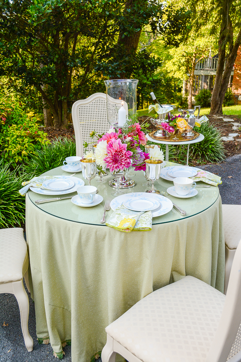 Grandmillennial summer table with Spode china, dahlias, and vintage linens