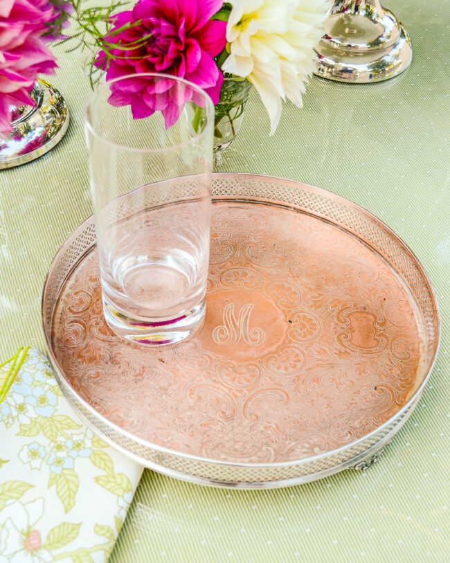 """Silverplate round tray with copper wash and """"M"""" monogram"""