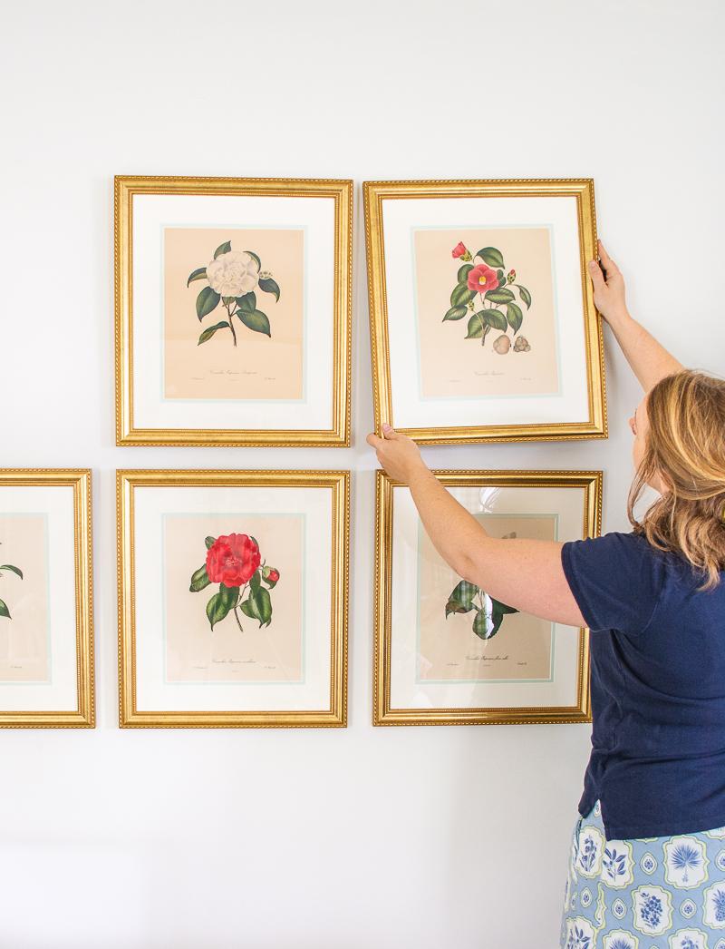 Katherine hangs botanical art in grid gallery wall