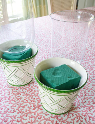 DIY mossy hurricane lanterns with green and white planters