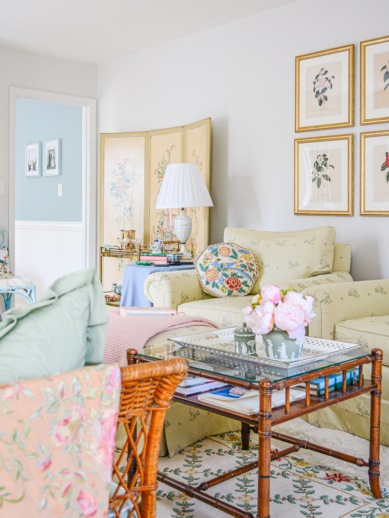 Katherine's grandmillennial living room in green and white with chintz, antiques, and Wedgwood