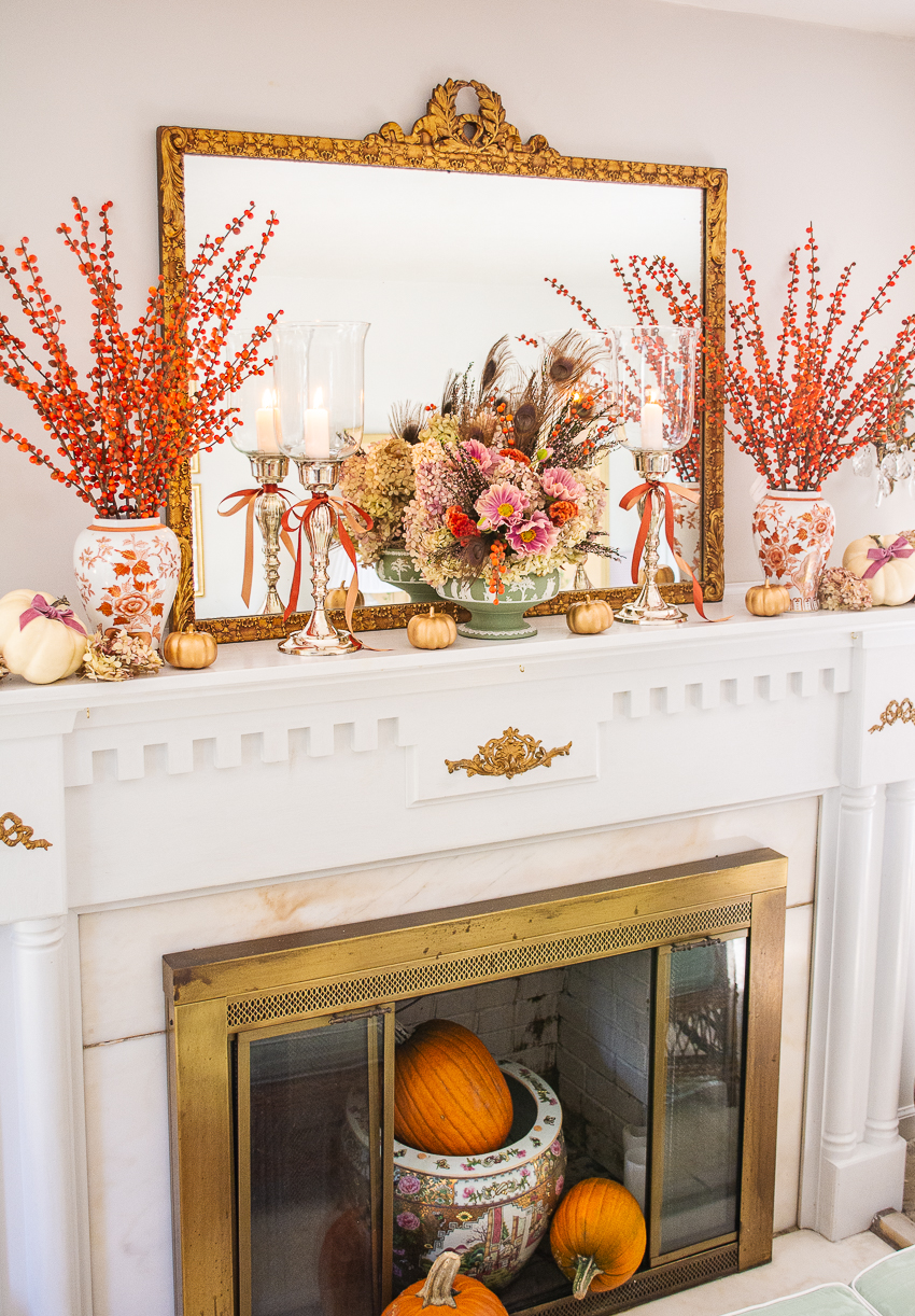 Decorate an elegant fall mantel using dried hydrangea, white pumpkins, orange berries, Chinese vases, and green Wedgwood Jasperware