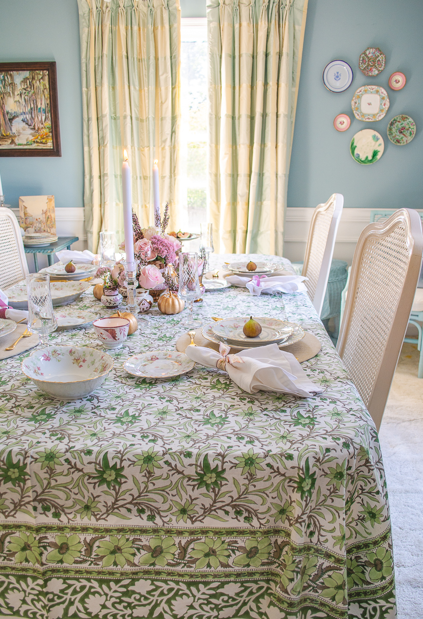 Pink and green fall table with Indian block print cloth, pink roses, copper luster, and Bavarian maple leaf china