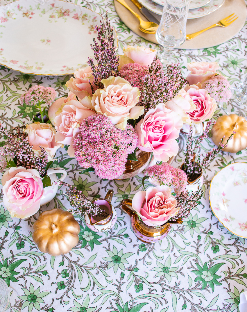 Fall centerpiece with pale pink roses, heather, and copper luster pitchers