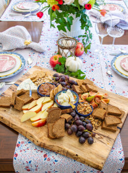 Autumn cheese board with figs, grapes, apples, and mascarpone