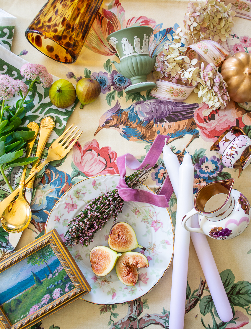 Delicious autumn decor inspiration for the grandmillennial - flatlay of fall themed antiques, decor, tableware