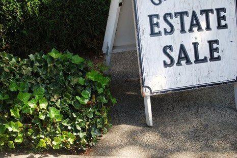 white and black estate sale sign