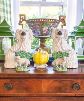 Classically charming curios: Pair of Staffordshire spaniels and sheep with Rose Medallion ormolu bowl in back