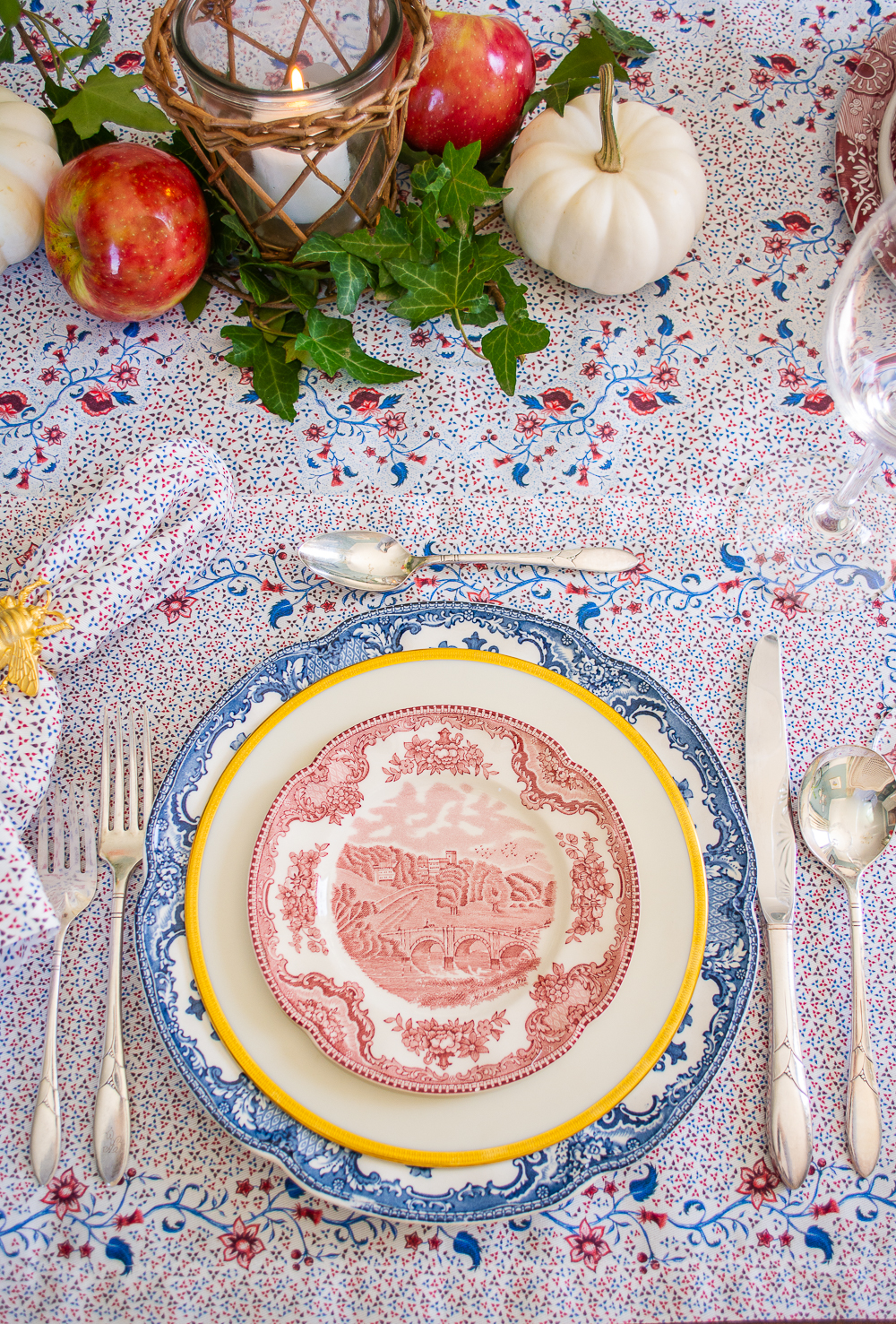 Fall table place setting with Johnson Bros transferware in red and blue on placemat from Sarah Flint